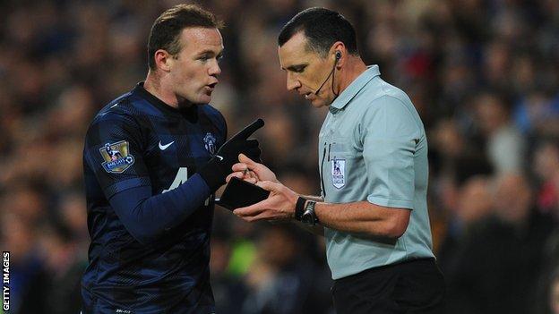Wayne Rooney talking with referee Neil Swarbrick