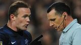 Wayne Rooney talking with referee Neil Swarbrick