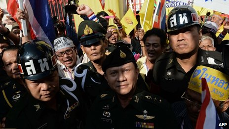 Thai military officials look up towards opposition protesters in Bangkok on 25 November 2013
