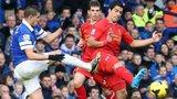 Kevin Mirallas tackles Luis Suarez