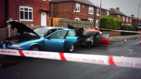 Damaged cars in Valley Road in Nottingham
