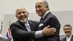Iranian Foreign Minister Mohammad Javad Zarif hugs French Foreign Minister Laurent Fabius in Geneva (24 November 2013)