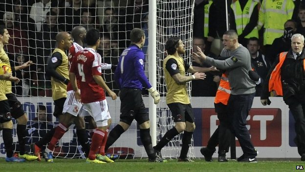 A Swindon Town fan confronts Leyton Orient's Romian Vincelot during the match at the County Ground, Swindon