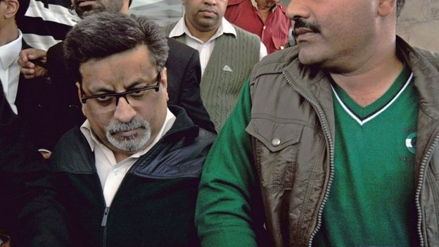 Indian defendant Rajesh Talwar (L) heads to court in Ghaziabad, some 30 kms east of New Delhi, on November 25, 2013