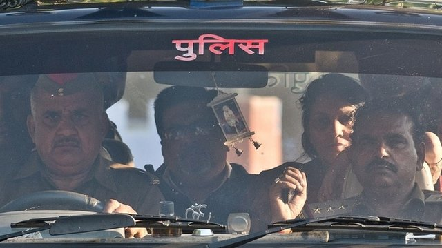 Rajesh Talwar (2nd L) and his wife Nupur Talwar (2R) arrive at Dasna Prison