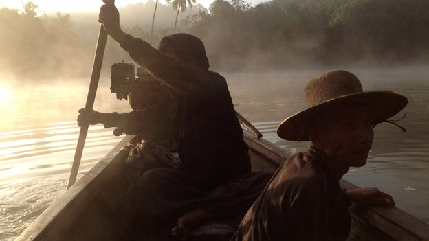 Early morning boat journey from base camp to search for a herd of elephants in Taung Lay