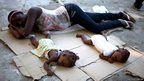 Marie Matte Mayan sleeps on the floor with he children in Croix-des-Bouquets, Haiti