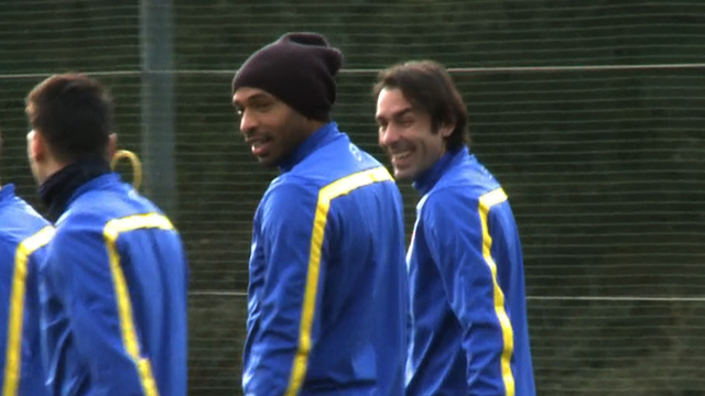 Former Arsenal players Thierry Henry and Robert Pires