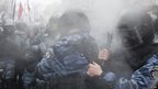 Police react to pepper spray in Kiev, Ukraine, 25 Nov