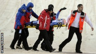 Ski jumper Andreas Kofler is stretchered away after a crash
