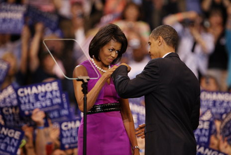 Fist bump between Michelle and Barack Obama