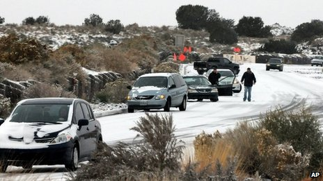 Cars slide in Albuquerque, New Mexico after a winter storm on 24 November 2013