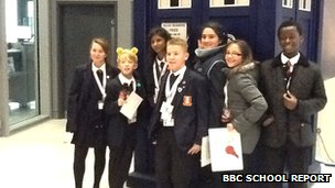 School Reporters from Northwood School posing in front of Dr Who's tardis