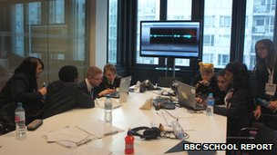The pupils from Northwood School working in teams around laptops to edit their work