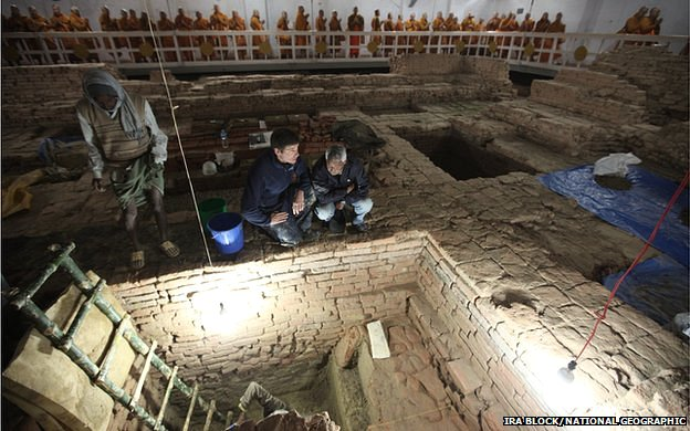Archaeologists Robin Coningham (left) and Kosh Prasad Acharya direct excavations within the Maya Devi Temple, while Thai monks meditate