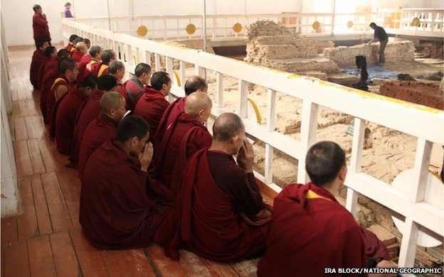 Monks chant within the Maya Devi Temple at Lumbini in Nepal