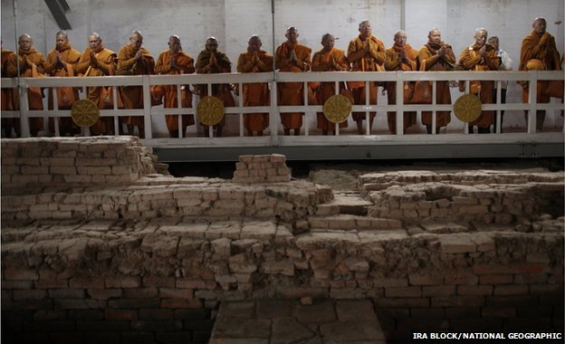 Thai monks inside the Maya Devi Temple meditate over the remains of the oldest Buddhist shrine in the world