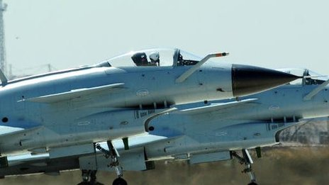 Chinese jets take off in Tianjin.