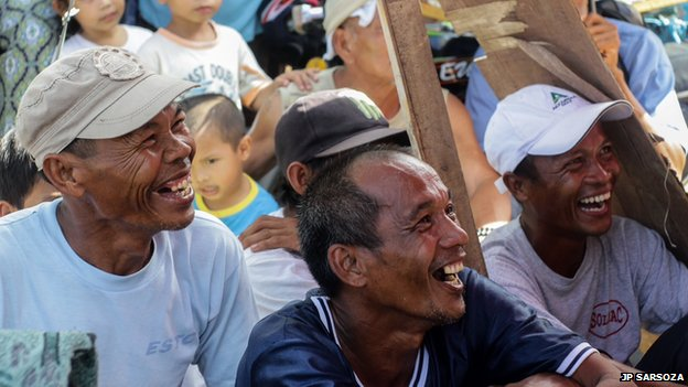 Men from Estancia town on Panay Island, central Philippines rejoice over the win of Pacquiao against Rios last Sunday. Photo: JP Sarsoza