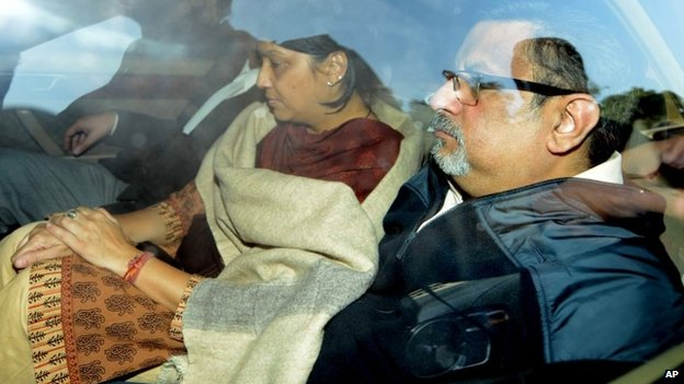 Rajesh Talwar and his wife Nupur Talwar are driven away in a police van after the verdict