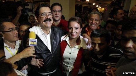 Xiomara Castro and her husband, Honduras' former President Manuel Zelaya, leave a hotel in Tegucigalpa November 24, 2013