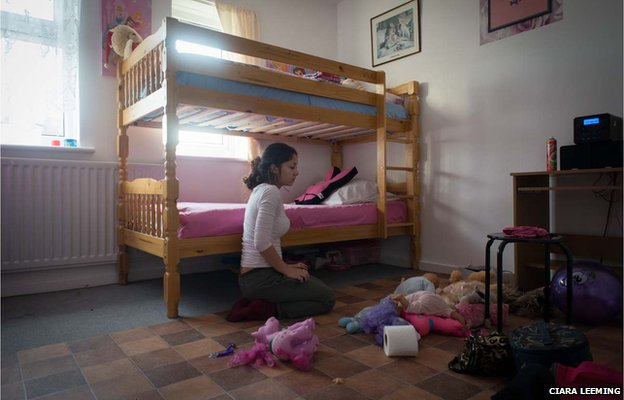 Fifteen-year-old Katerina tidies the room she shares with her nine-year-old sister Andrea