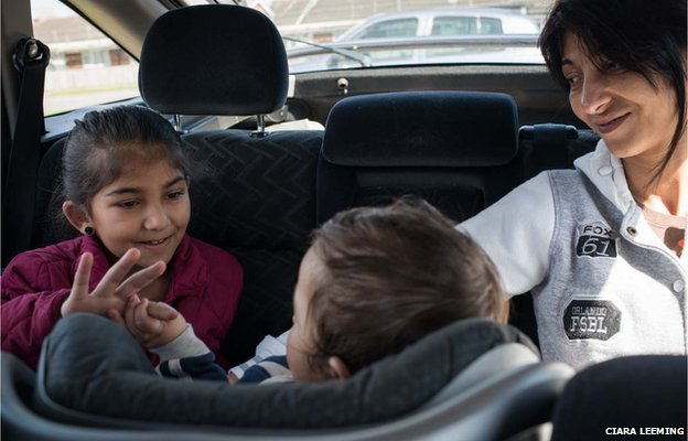 Zaneta, daughter Andrea, nine, and baby grandson Roman in the car
