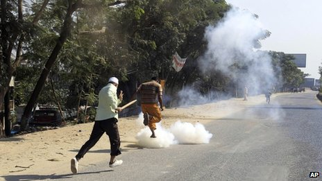 BNP activists run for cover from tear gas shells