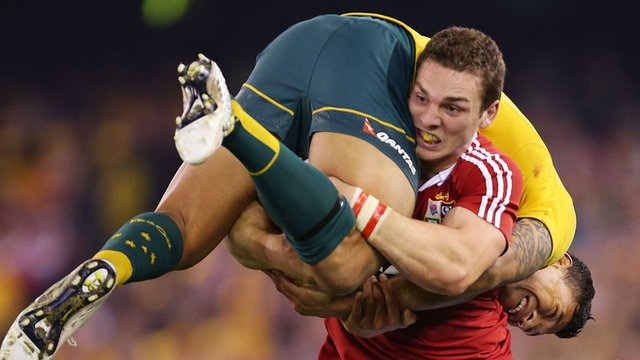 George North carries Israel Folau