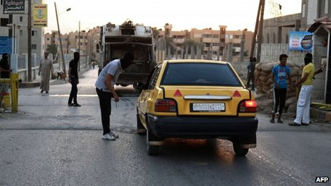 "Self-styled ""Islamist Police"" stop vehicles in Raqqa (3 September 2013)"