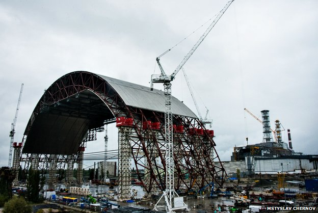 The arch being built at Chernobyl, with the nuclear reactor in the background