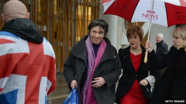 Nicola Sturgeon entering the parliament