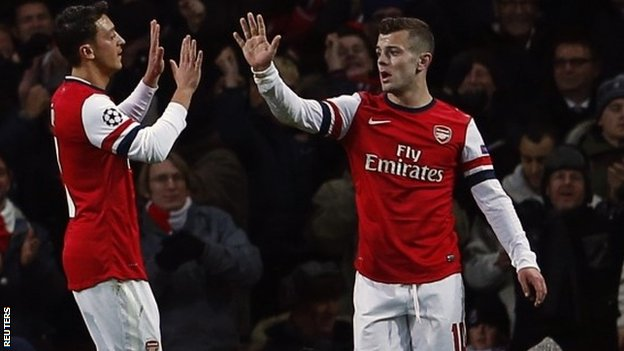 Mesut Ozil (left) with Jack Wilshere