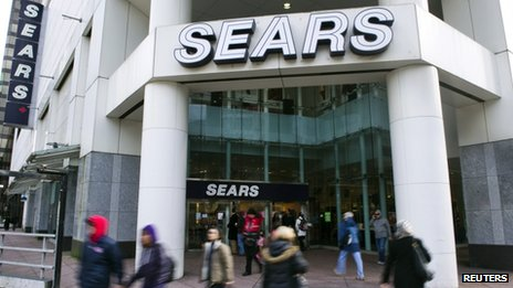 People walk past the main Sears store in downtown Vancouver, British Columbia, on 23 February 2011
