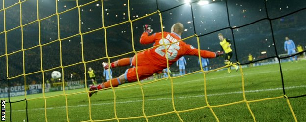 Borussia Dortmund forward Marco Reus opens the scoring against Napoli