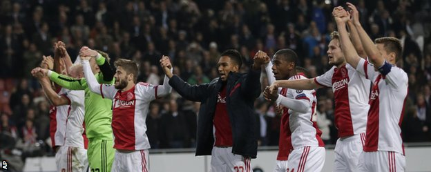 The Ajax players celebrate their victory against Barcelona