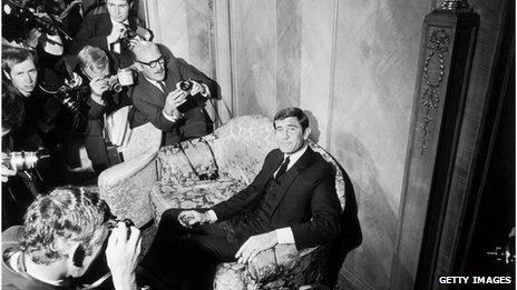 Actor George Lazenby, shown in 1968 - sitting on a chair