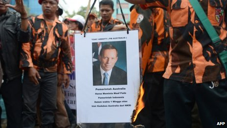 Members of Pemuda Pancasila burn a picture of Australia's Prime Minister Tony Abbott during a protest against claims that Australian spies targeted the phone of Indonesian President Susilo Bambang Yudhoyono, outside the Australian embassy in Jakarta on November 26, 2013.