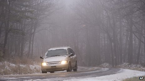 A car travels in Conyngham Township, Pennsylvania, on 26 November 2013