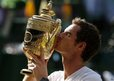 Andy Murray kissing Wimbledon trophy