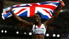 Christine Ohuruogu holding up a union flag