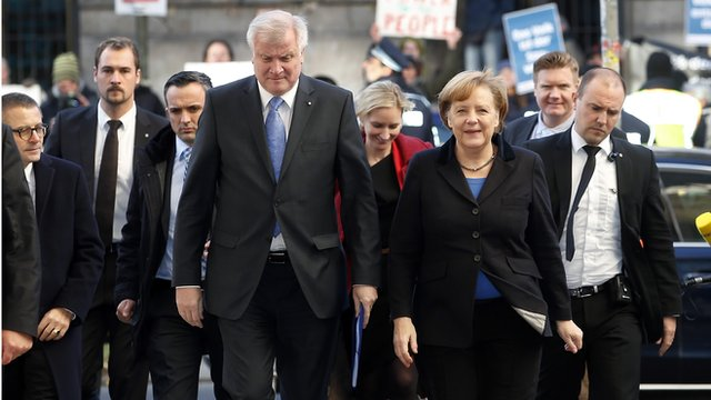 Horst Seehofer (CSU) and Angela Merkel (CDU) arrive for a meeting with the SPD