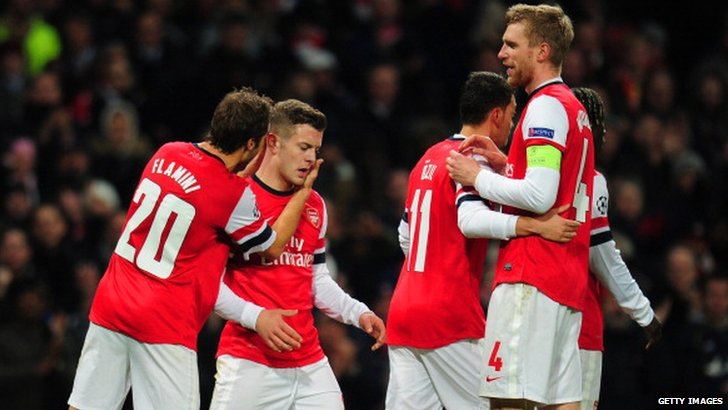 Arsenal players congratulate Jack Wilshere after the midfielder scored against Marseille