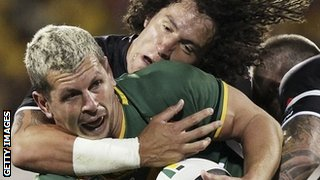 Australia's Greg Bird is tackled by New Zealand's Kevin Proctor