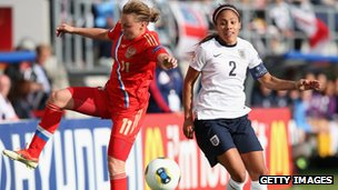 Alex Scott in action during her 100th game for England against Russia
