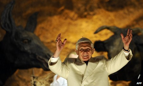 Pope Benedict XVI blesses the faithful in front of the nativity in St. Peter's Square