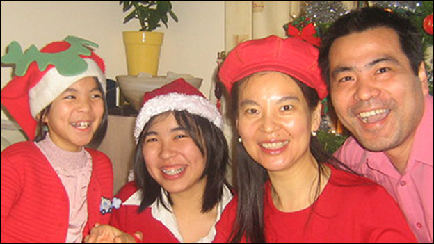 Ding family in Christmas hats