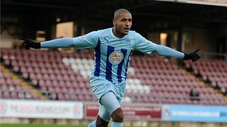 Leon Clarke celebrates another goal at a deserted Sixfields