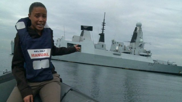 Leah Gooding in front of HMS Daring