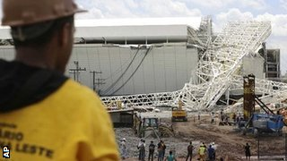 A worker looks on at the scene of the disaster at the Arena Corinthians